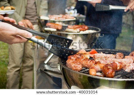 Group of People on a Barbecue - stock photo