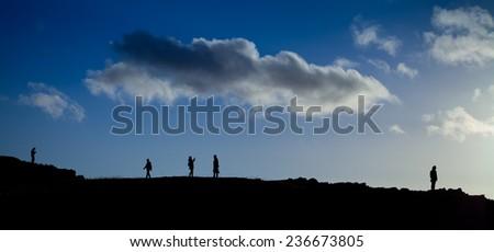 Group of people on a Scottish hill- Arthur Seat. Landscape view. Scottish landscape. sunset, view, tourism, traveling, walking.  - stock photo