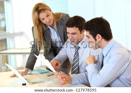 Group of people on business project presentation - stock photo