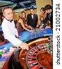 group of people on the casino roulette playing - stock photo