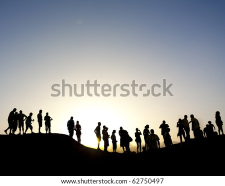 Group of people on top of a mountain in the sinai desert, northern egypt