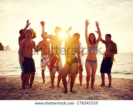 Group of People Partying on Beach at Sunset