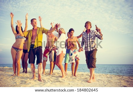 Group of people partying on the beach. - stock photo