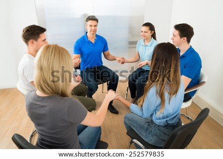 Group Of People Playing Together Holding Hands - stock photo
