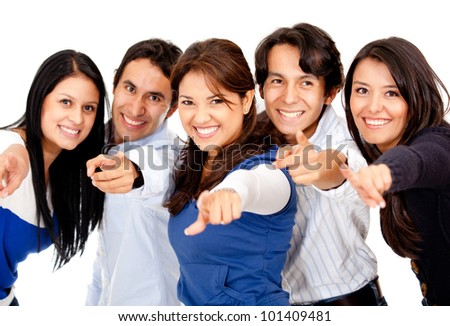 Group of people pointing at the camera - isolated over white - stock photo