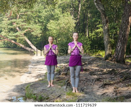 Group of people practicing yoga - stock photo