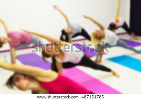 Group of People Practicing Yoga at Health Club Blurred. Yoga, Sport, Fitness, Lifestyle and People Concept.
