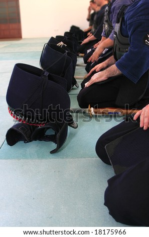 Group of people preparing to fight; Kendo equipment (japanese fencing); - stock photo