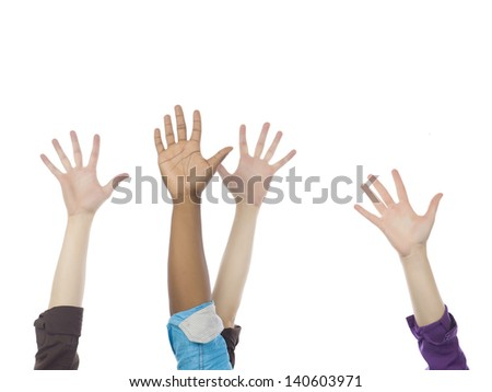 Group of people raising their hands - stock photo