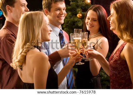Group of  people  raising up bocals of champagne making a toast