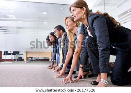 Group of people ready to race in an office - stock photo