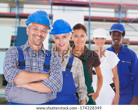 Group Of People Representing Diverse Professions At Construction Site - stock photo