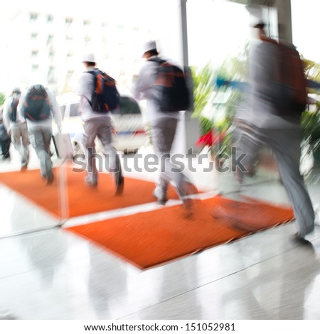 Group of people rushing in the lobby. motion blur - stock photo