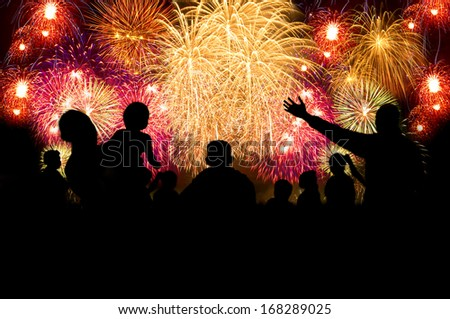 Group of people silhouette enjoy watching firework show in the night sky - stock photo
