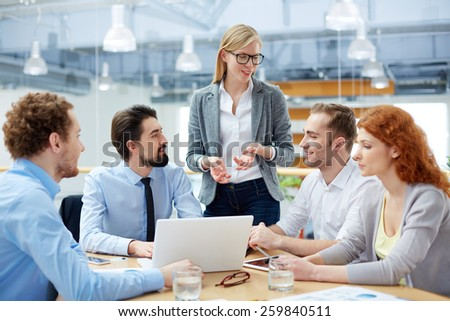 Group of people sitting at discussion - stock photo