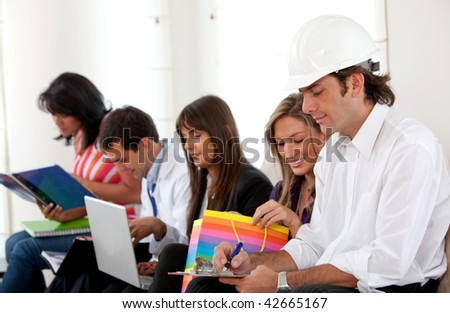 Group of people sitting doing their jobs indoors