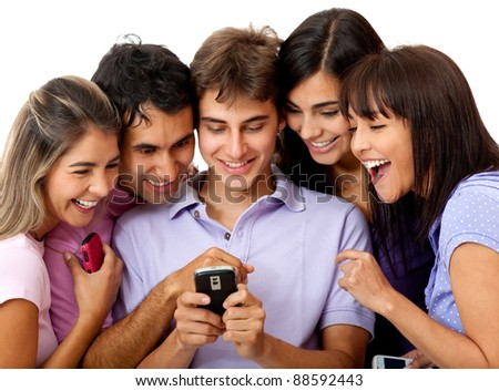 Group of people social networking on a cell phone - isolated over white - stock photo
