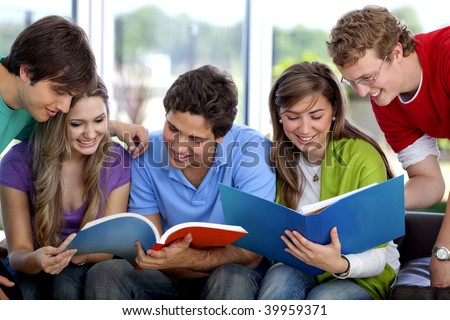 Group of people studying with books smiling