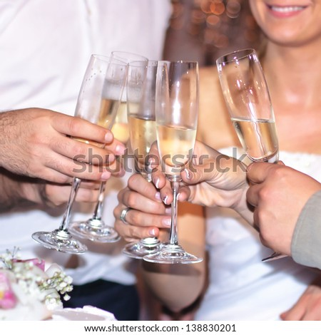 Group of people toasting with champagne at wedding. - stock photo