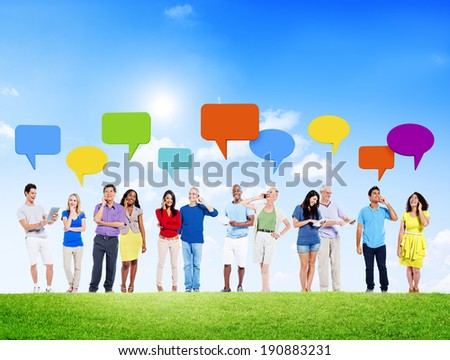 Group of People Using Devices with Speech Bubble Outdoors