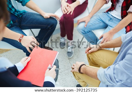 Group of people visiting course of psychological therapy - stock photo