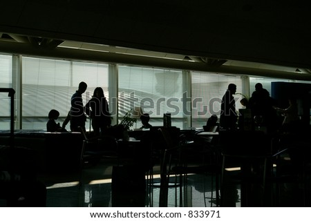 Group of people waiting in an Airport Launch. - stock photo