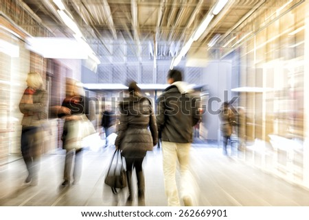 Group of people walking in shopping office,  zoom effect, motion blur - stock photo