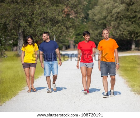 Group of People Walking Outside - stock photo