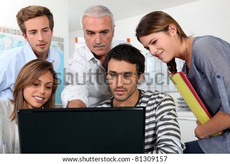group of people watching a screen - stock photo