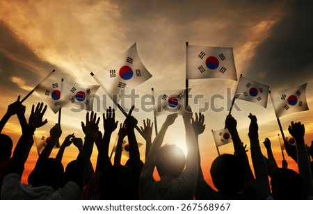 Group of People Waving South Korea Flags in Back Lit