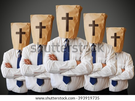 Group of people with a paper bag with the cross on it