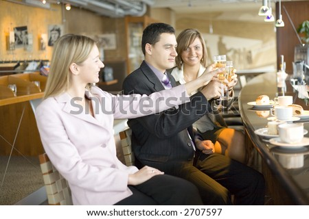 Group of People With Glasses of Champagne. Short Depth of Focus (On Man's Face). - stock photo