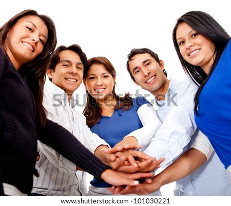 Group of people with hands together in the middle - isolated - stock photo
