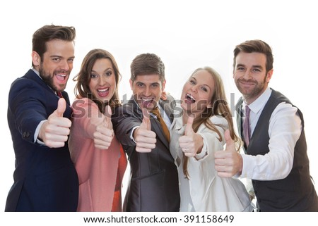 group of people with thumbs up for success - stock photo