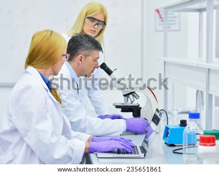 group of people working in the laboratory - stock photo
