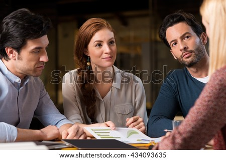 Group of people working together on a project. Business team analyzing graph and growth potential. Colleagues listening to manager and understanding plans.  - stock photo