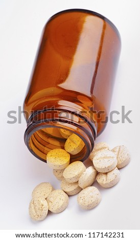 group of pharmaceutical tablets, leaving a plastic boat - stock photo
