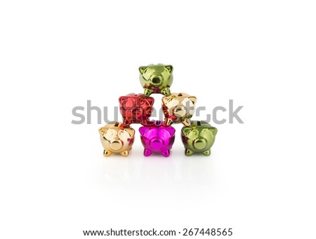 group of Piggy Banks stacked in a triangle shape - stock photo