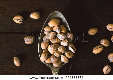 Group of pistachios in spoon,selective focus  - stock photo