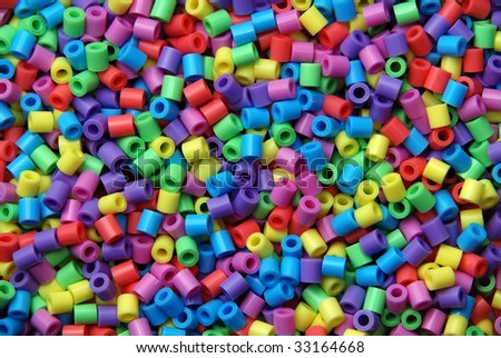 Group of plastic beads of many colors - stock photo