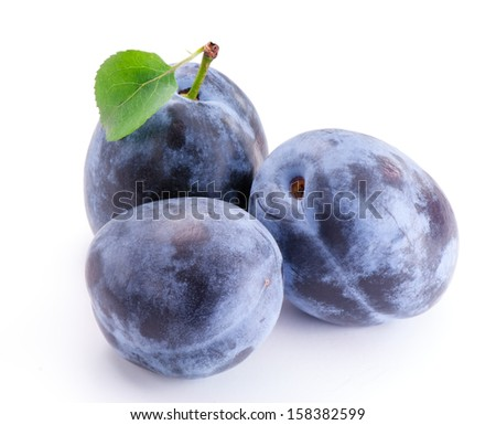Group of plums with leaf isolated on white - stock photo