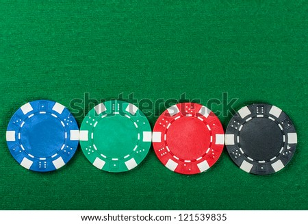 Group of poker chips on the green cloth.