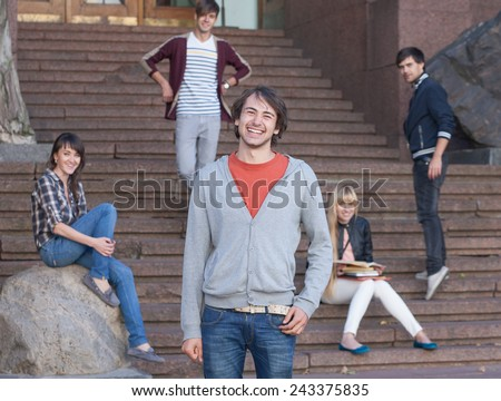 Group of positive students outdoor near university - stock photo
