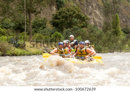GROUP OF POWERFUL YOUNG MEN ON A RAFTING BOAT PATATE RIVER, ECUADOR SHOOT WITH CANON 1D MARK IV FROM WATER LEVEL   - stock photo