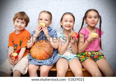 group of preschool children to eat apples - stock photo