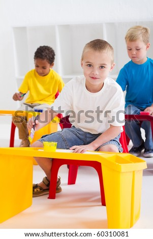 group of preschool kids in classroom - stock photo