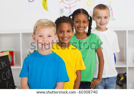 group of preschool students in classroom - stock photo