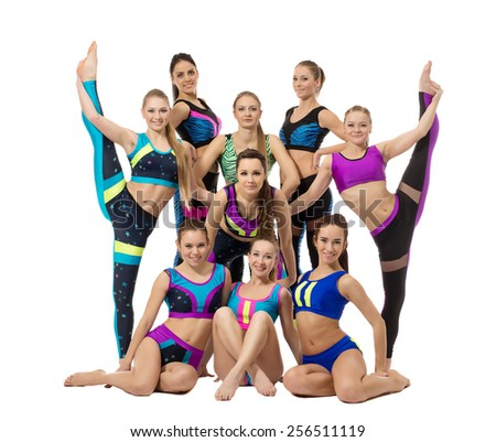 Group of pretty female gymnasts, isolated on white - stock photo