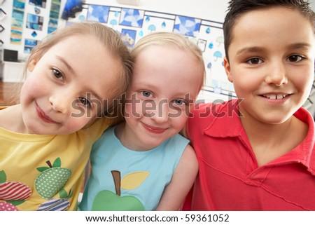 Group Of Primary Schoolchildren In Classroom - stock photo