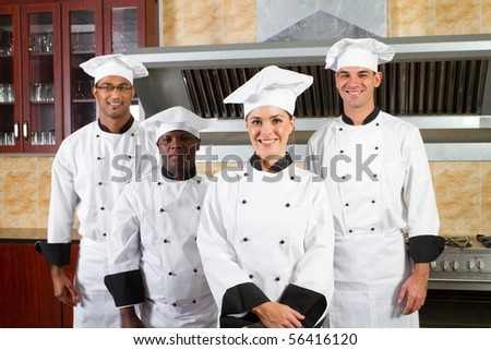group of professional chefs in hotel kitchen - stock photo